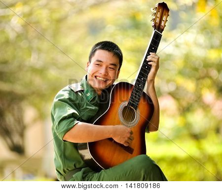LANG SON, Vietnam, February 18, 2016 army soldiers, Lang Son Province, Vietnam. Theater, entertainment, guitar