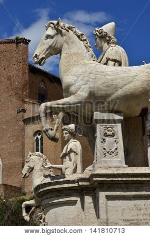 Castor and Pollux. Ancient marble statues of Dioskouri at the top of monumental balustrade in Capitoline Hill, Rome