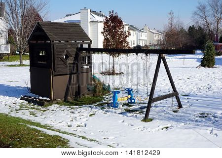 JOLIET, ILLINOIS / UNITED STATES - NOVEMBER 24, 2015: A playground in Joliet, after a November snow storm.