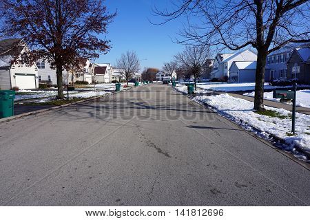 JOLIET, ILLINOIS / UNITED STATES - NOVEMBER 24, 2015: A residential street after a November snowstorm in Joliet, Illinois.