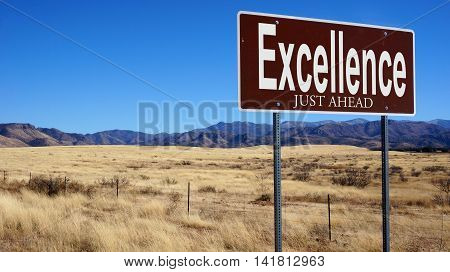 Excellence Just Ahead Brown Road Sign