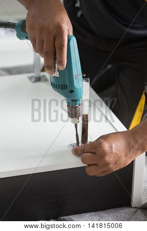 Assembling Furniture With A Screwdriver