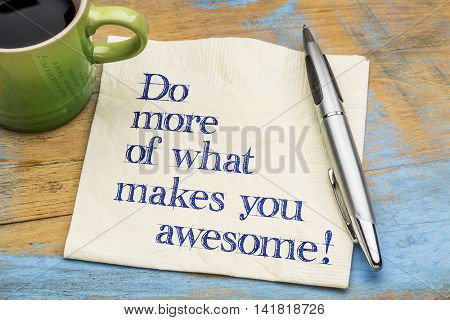 Do more of what makes you awesome - motivational handwriting on a napkin with a cup of espresso coffee