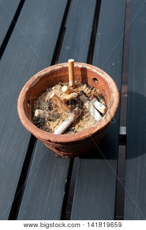 Full ashtray make by Pottery on wood