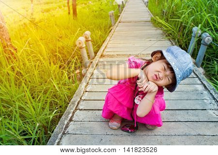 Happy Asian Girl Relaxing Outdoors With Bright Sunlight At The Day Time, Travel On Vacation.