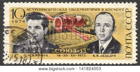 MOSCOW RUSSIA - CIRCA APRIL 2016: a post stamp printed in the USSR shows portrait of P. I. Klimuk and V. V. Lebedev the series