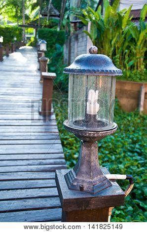 lamp on the wood bridge in a garden