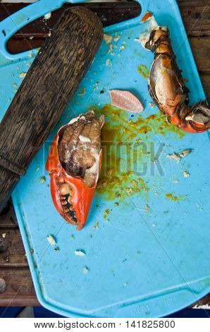 big claws of a crab ready to eat on chopping block