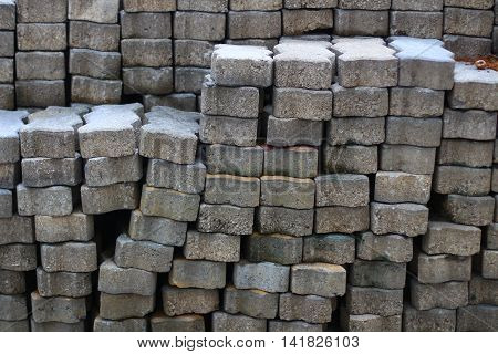 Piles of concrete blocks for pavement work