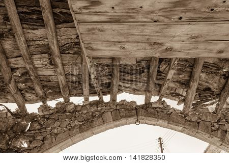 Wooden Beams And Stone Arch Of Derelict Building- Sepia Toned