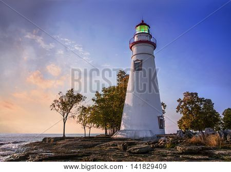 The Marblehead Lighthouse In The First Light Of Dawn On A Foggy Morning Over Lake Erie At Marblehead Ohio USA