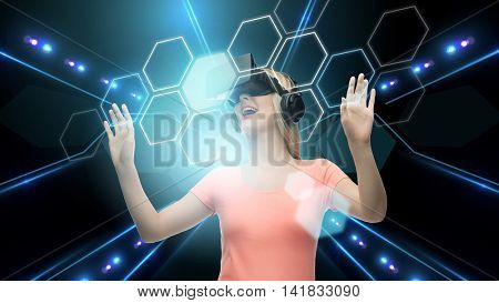 technology, virtual reality, cyberspace, network and people concept - woman with virtual reality headset 3d glasses touching screen projection of hexagonal cells over black background and laser light