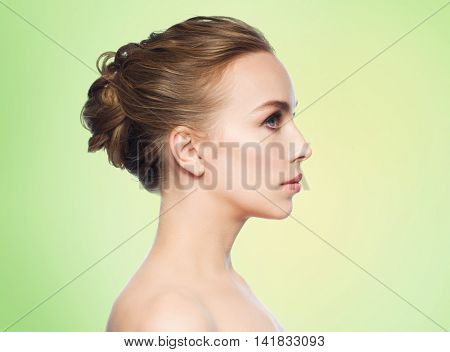 health, people, plastic surgery and beauty concept - beautiful young woman face over green background
