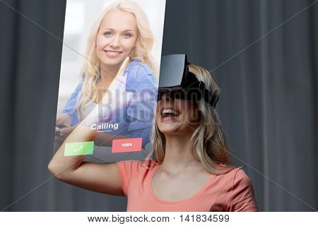 technology, virtual reality, cyberspace, entertainment and people concept - happy young woman with virtual reality headset or 3d glasses at home looking at incoming call projection