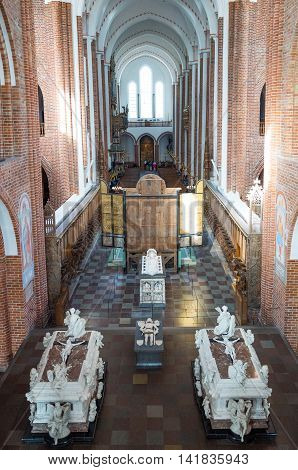 Roskilde Denmark - July 23 2015: Visitors and royal tombs in the nave of the medieval Cathedral
