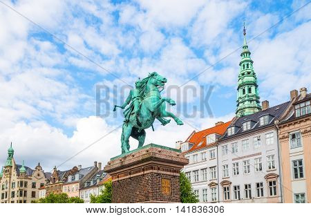 Copenhagen Denmark - July 20 2015: The traditional houses of Hojbro square with the equestrian statue of Bishop Absalon
