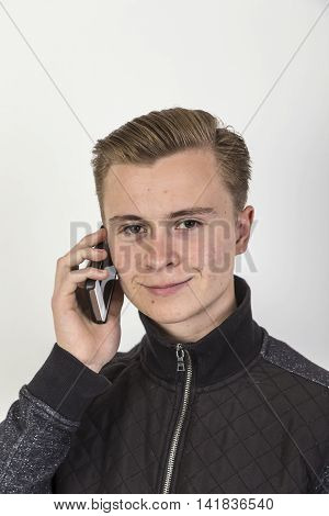 Handsome Teenage Boy In Black Shirt With Mobile