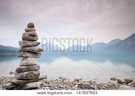 Balanced Stones On Mountain  Lakeshore. Children Built Pebbles Pyramid