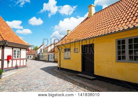 Odense Denmark - July 21 2015: Traditional houses in the old town with the Hans Christian Andersen home in the foreground right