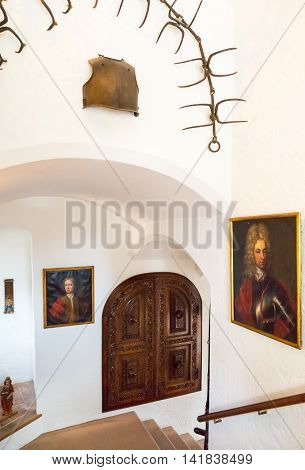 Kvaerndrup Denmark - July 21 2015: Paintings on the entrance stairway of the Egeskov castle