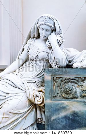 Roskilde Denmark - July 23 2015: Detail of the statue of a grieving woman of the Frederik V sarcophagus in the medieval Cathedral