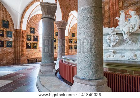 Roskilde Denmark - July 23 2015: The chancel with the Royal tombs and the ancient priest portraits in the medieval Cathedral