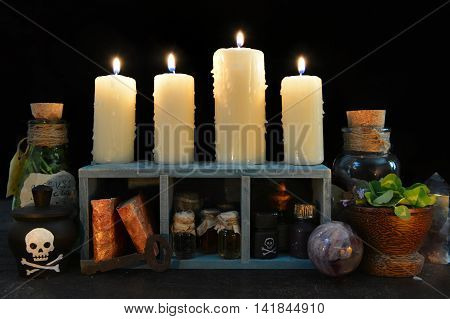 Still life with burning candles and magic objects. Halloween background