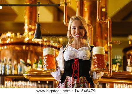 Young girl with a beer mug
