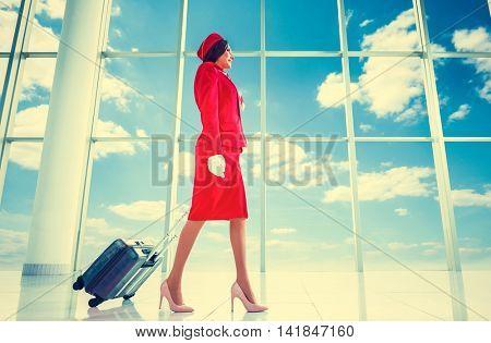 Young stewardess at airport