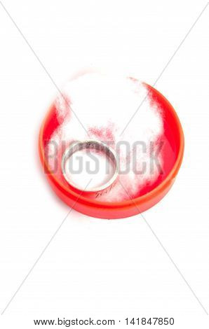 Silver ring in red jeweler box on white