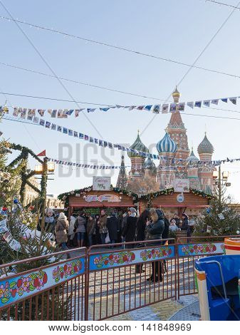 Moscow - November 29 2015: Large Christmas fair on the Red Square and a lot of people walking in the Christmas holidays St. Basil's Cathedral and Christmas decorations November 29 2016 Moscow Russia