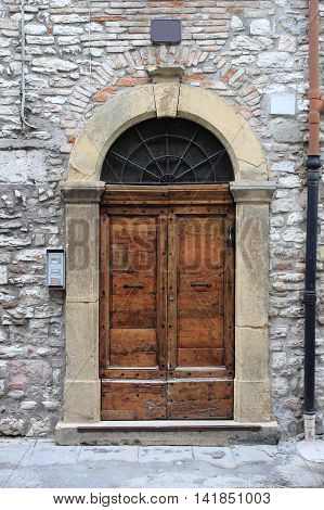 An ancient wooden medieval style front door