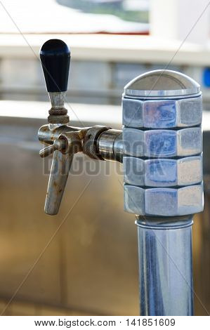 Aging steel beer tap for pouring from keg