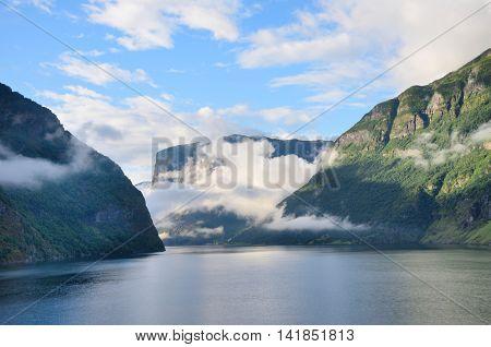 Sognefjorden in norwegian Fjords with cloudy sky