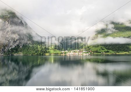 Norwegian village with refections on in Norweigian fjords