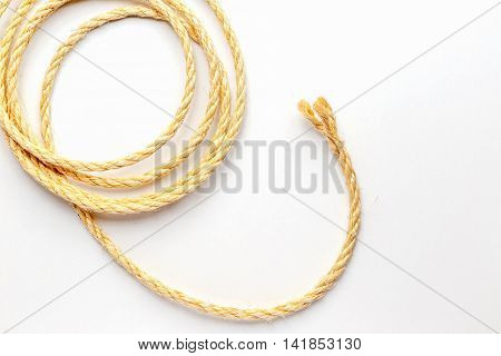 coiled rope on a white background close up isolated