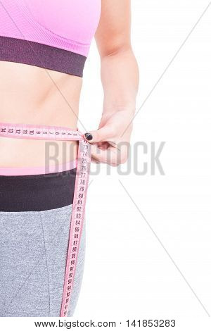 Side View Of Fit Woman Waist With Tape Line