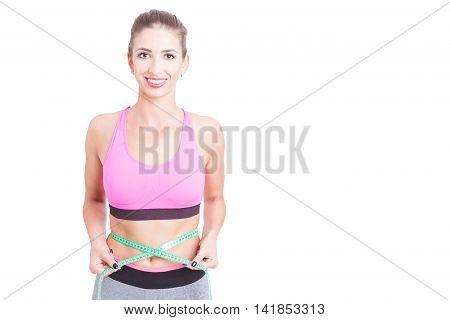Girl At Gym Holding Centimeter Around Waist