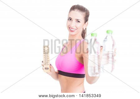 Selective Focus Of Fit Woman Holding Water And Thermometer