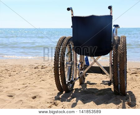 Wheelchair On The Sand Of The Beach