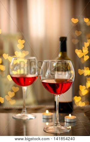Romantic composition with wine on blurred background