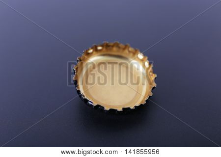 Metal bottle cap on color background