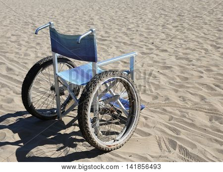 Wheelchair On The Sand Of The Beach