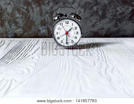alarm clock on an empty locker on white background