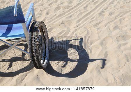 Shadow Of A Wheelchair On The Beach