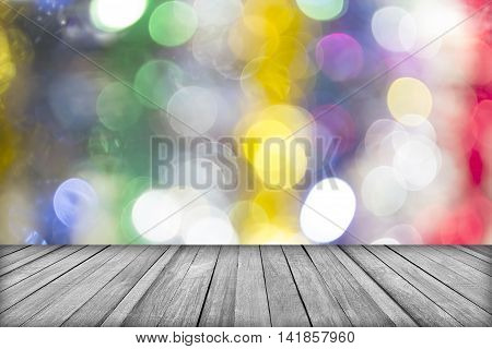 image of wood table and blurred bokeh background with colorful lights (blurred)