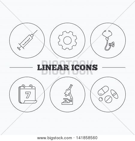 Syringe, stethoscope and microscope icons. Medical pills linear sign. Flat cogwheel and calendar symbols. Linear icons in circle buttons. Vector