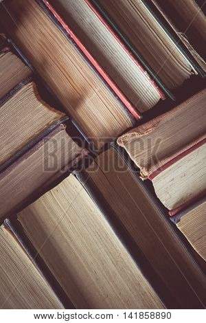 vintage tone of Old and used hardback book or text book seen from above.
