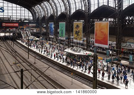 Hamburg, Germany - August 5, 2016: People waiting for their train on the platform at the central station