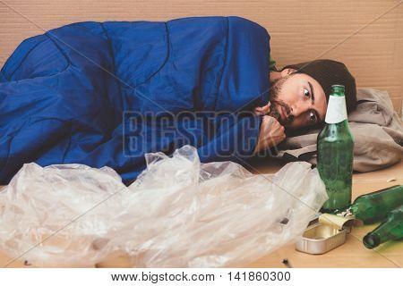 Homeless lying on the street alone sad